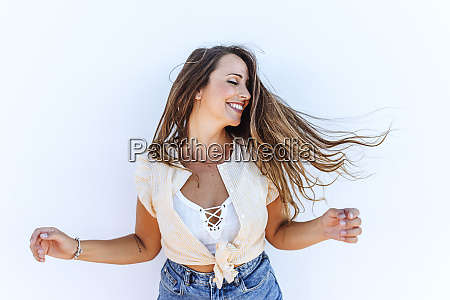 happy young woman shaking her hair