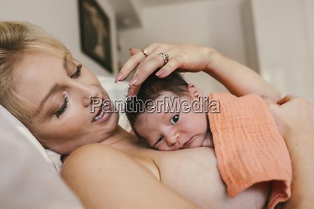 newborn baby lying skin to skin