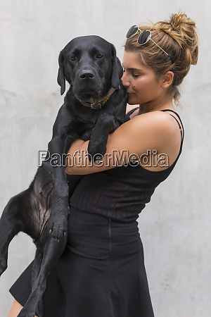 portrait of black dog with owner