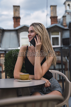 smiling blond woman on the phone