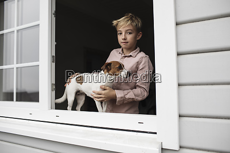portrait of boy with jack russel