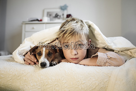 portrait of blond boy and his