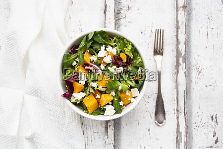 bowl of autumnal salad with feta