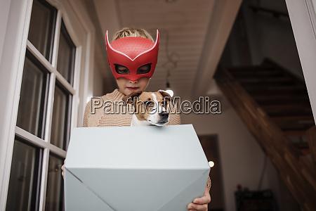 boy wearing superhero mask with jack