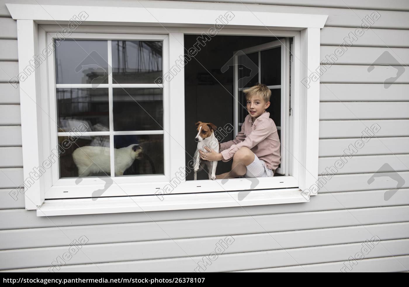 portrait, of, boy, sitting, on, window - 26378107