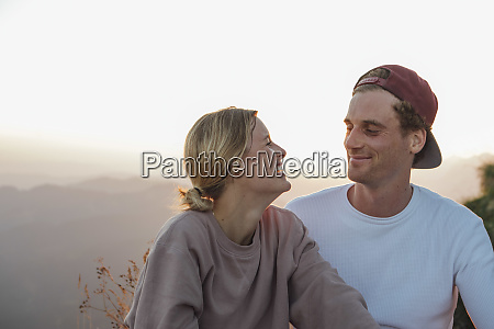 happy young couple on a hiking