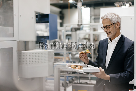manager in high tech company eating