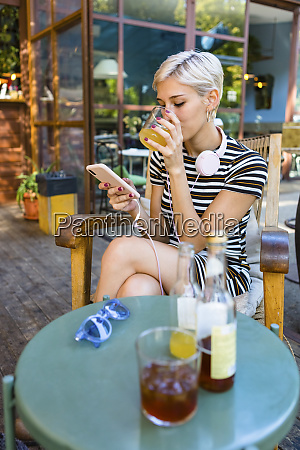 young woman at pavement cafe enjoying