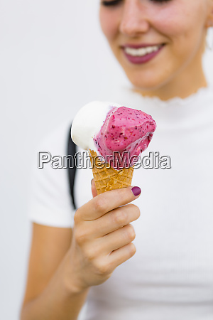 womans hand holding ice cream close