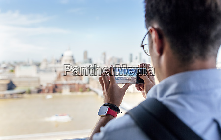 uk london man taking a picture
