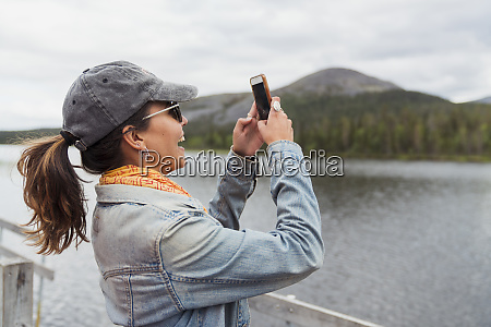 finland lapland happy woman on jetty