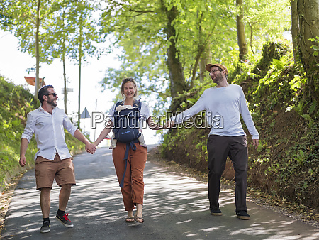 happy parents with baby girl strolling