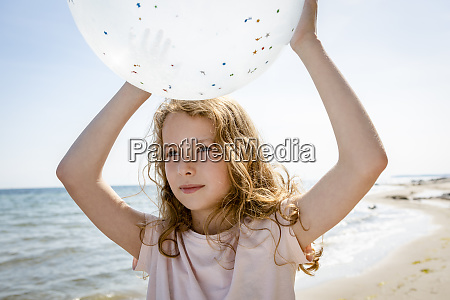 girl holding a balloon at the