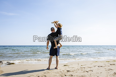 father and son playing at the