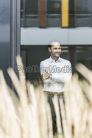 portrait of smiling businessman looking out