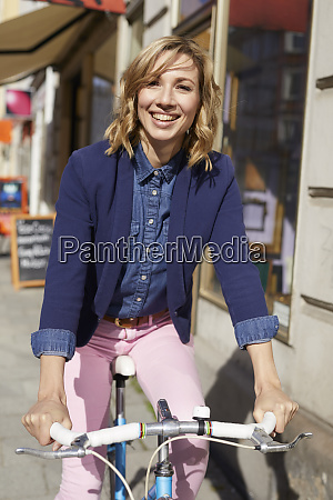 blond woman riding a bike in