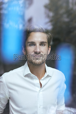 portrait of relaxed young businessman behind