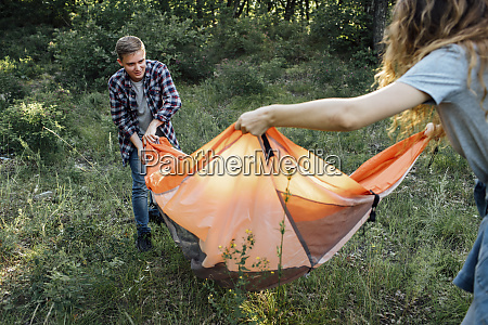 young couple camping in nature setting