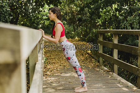 young woman practicing pilates in an