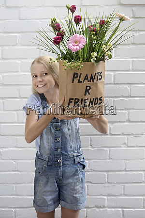 portrait of smiling girl holding paper