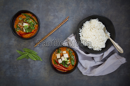 two bowls of red thai curry