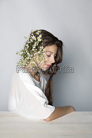 portrait of girl wearing flowers