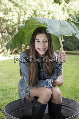 portrait of smiling girl under big