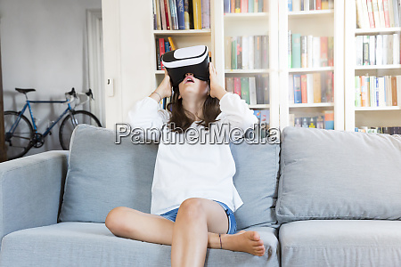 amazed girl sitting on the couch