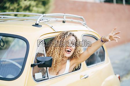 portrait of happy blond woman leaning