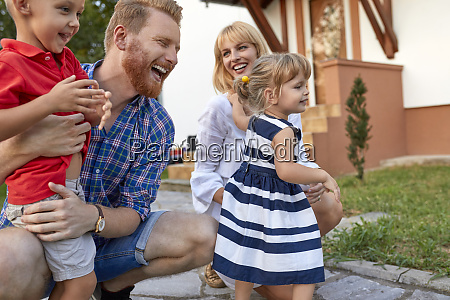 happy family in garden of their