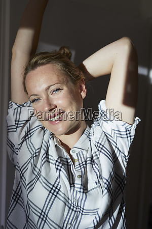 smiling woman stretching in the morning