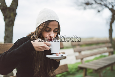 portrait of young woman drinking cup