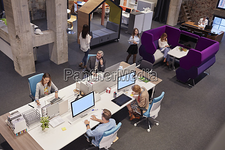 people working in big modern office