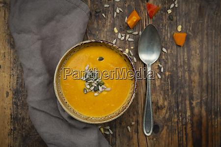 pumpkin soup with pumpkin and sunflower