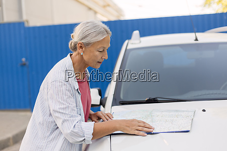 senior woman looking at road map