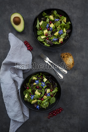 two bowls of mixed salad with
