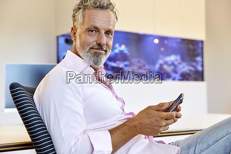 portrait of confident businessman sitting in