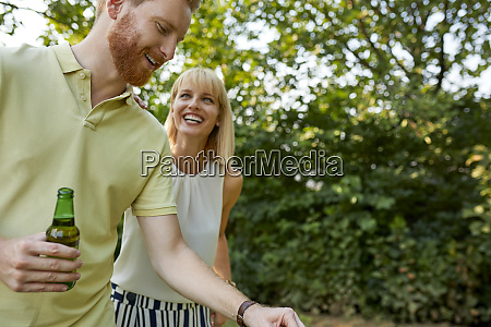 happy young couple having a barbecue