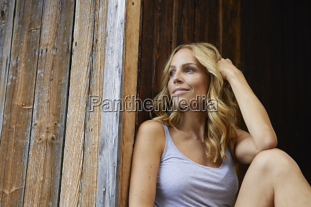 smiling blond woman in front of