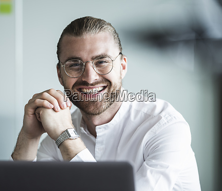 portrait of smiling young businessman in