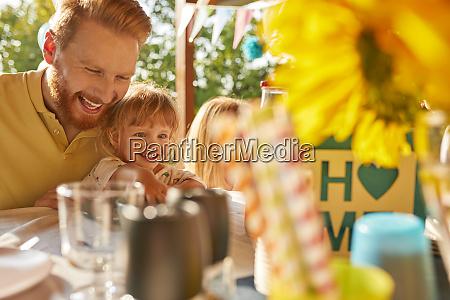 happy family having a garden party