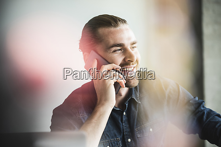 portrait of smiling young businessman on