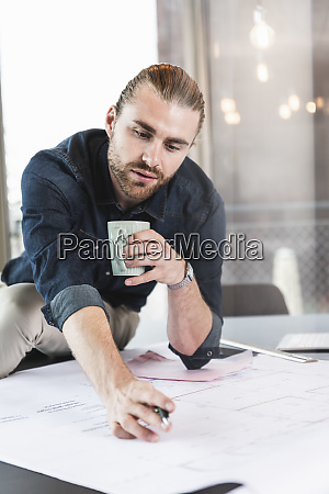 young businessman working on plan at