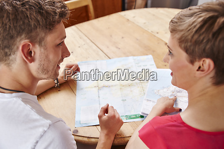 young couple sitting at table at