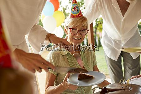 serving cake on a birthday garden