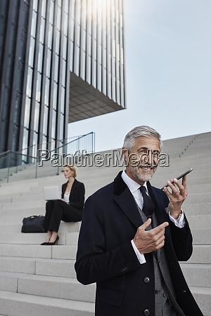 portrait of businessman talking on mobile