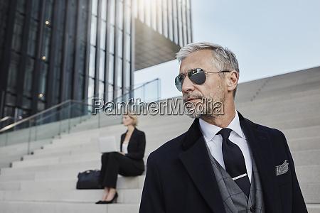 portrait of fashionable mature businessman wearing