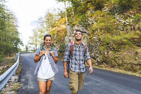 italy massa smiling young couple walking