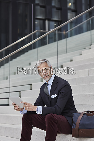 portrait of fashionable businessman with travelling