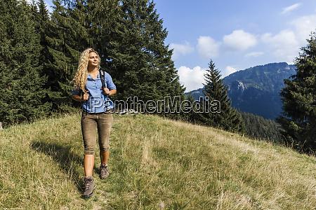 germany bavaria oberammergau young woman hiking